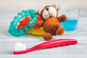 kids dental office in Delaware, Ohio displaying toothbrush, teddy bear, and ring for teething baby